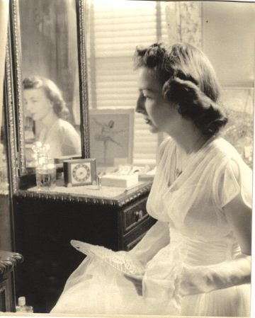 Mom looking in mirror